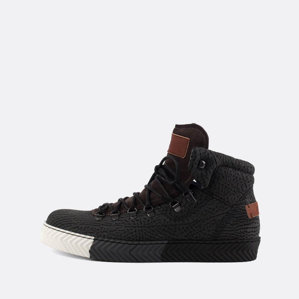 High top sneakers in black printed leather with a distinct sole.