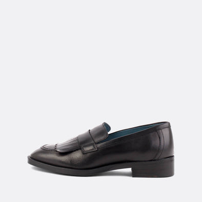 Black leather loafers with matching fringe.