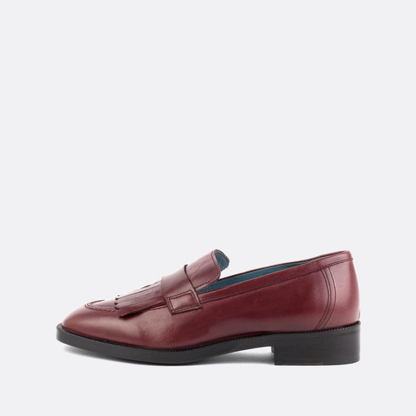 Bordeaux leather loafers with matching fringe.