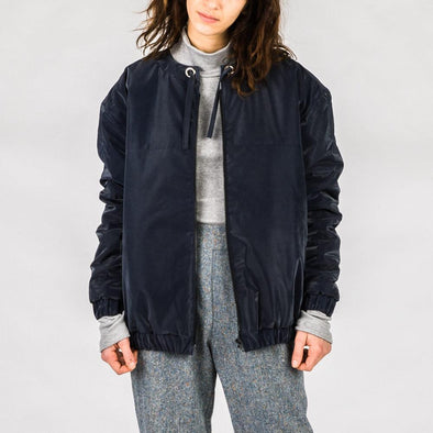 Navy blue padded bomber jacket.