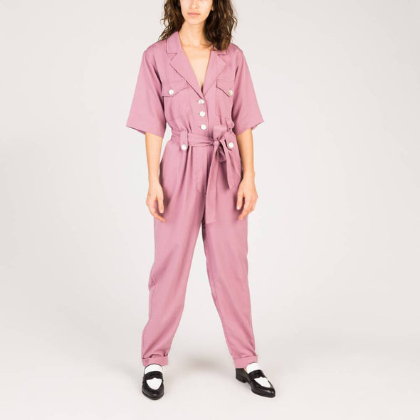 Dusty purple sustainable boiler suit with a revere collar, short sleeve, tapered leg and side pockets.