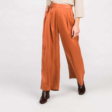 Rust wide leg high waisted trousers with front pleats.