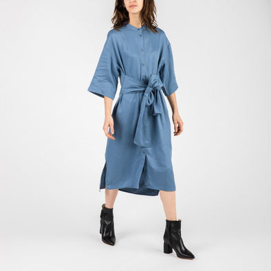 Blue midi length dress with dropped shoulder and self tie waist.