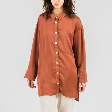 Luxe oversized rust shirt with long wide sleeves and oversized cuffs.