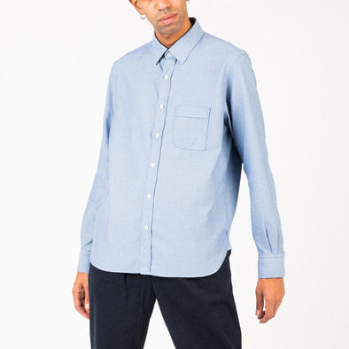 Timeless light blue shirt.