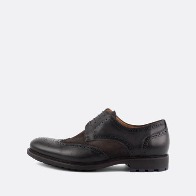 Classic black and brown leather derby shoes with broguing details.
