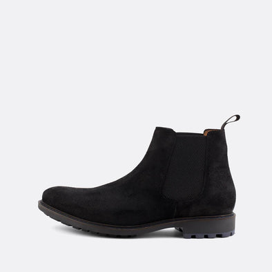 Classic black suede chelsea boots.