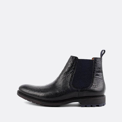 Black chelsea boots in crocodile embossed leather.