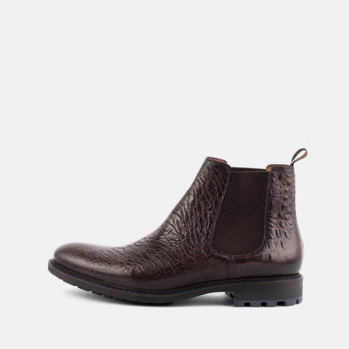 Brown chelsea boots in crocodile embossed leather.
