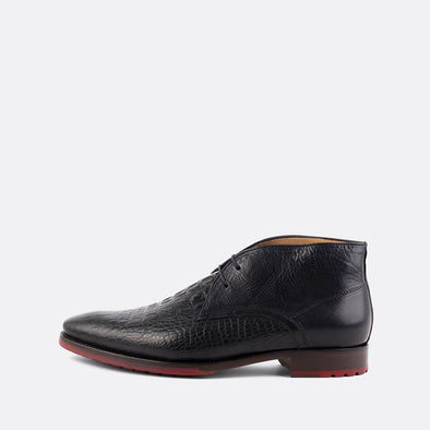 Black chukka boots in crocodile embossed leather.