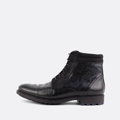 Black lace-up boots in crocodile embossed leather.