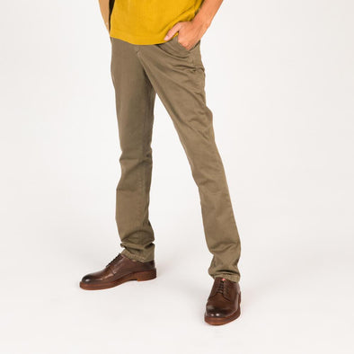 Khaki regular fit trousers with fly zipper and old looking buttons.