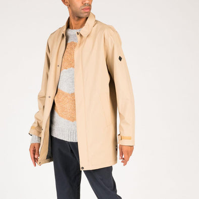 Beige jacket with two side pockets and inner wallet pocket.