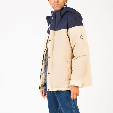 Navy blue and beige puffy jacket with detachable padded hood.