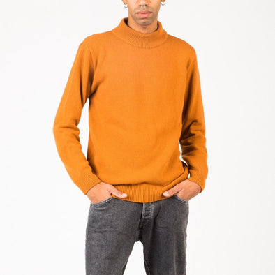 Mock turtleneck in a four ply knit of orange wool yarn.