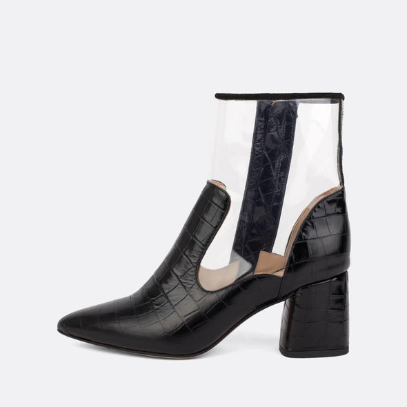 Heeled boots in croc black leather and transparent vinyl.