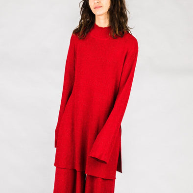 Red knitted turtleneck.