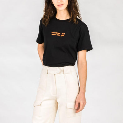 Black t-shirt with orange embroidery quote.