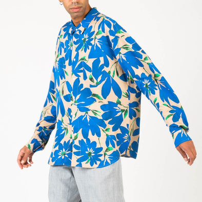 Long sleeved shirt with floral print in shades of blue, beige and green.