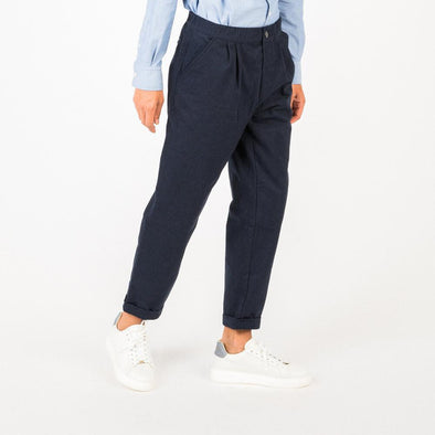 Navy blue trousers with elasticated waist.