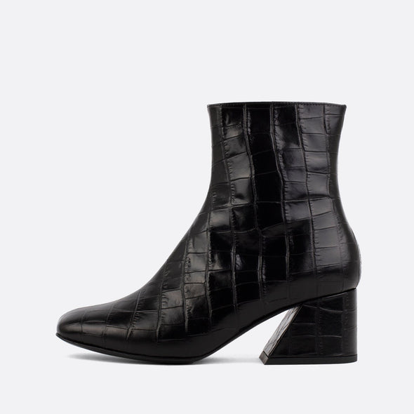 Square toe boots in black crocodile embossed leather.