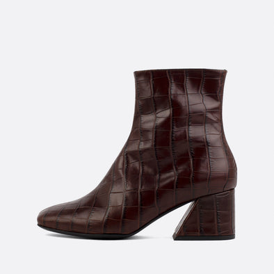 Square toe boots in brown crocodile embossed leather.