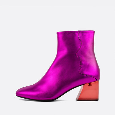 Bold metallic leather square toe boots with an oblique heel.
