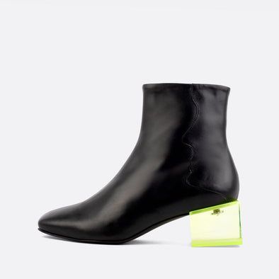 Black leather square toe boots with yellow acrylic cube shaped heel.