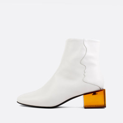 White leather square toe boots with brown acrylic cube shaped heel.