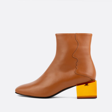 Camel leather square toe boots with brown acrylic cube shaped heel.