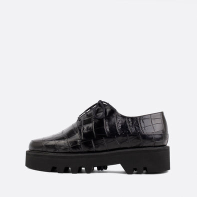 Black lace-up creepers with bold lightweight platform sole.