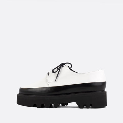 Black and white lace-up creepers with bold lightweight platform sole.