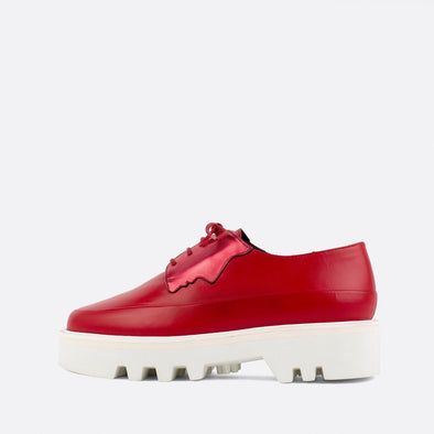 Red lace-up creepers with bold lightweight platform sole and metallic details.