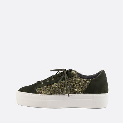 Forest green low top sneakers in leather and fabric.