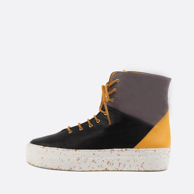 Leather and suede high-top sneakers in black, grey and yellow.