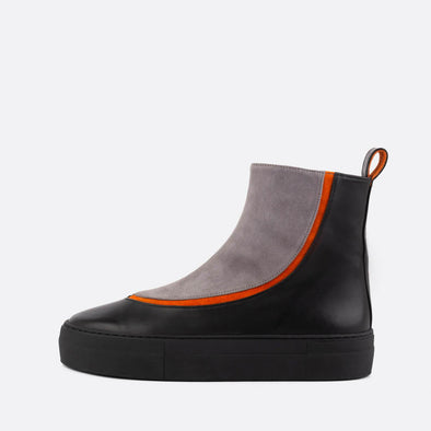 Leather and suede high-top sneakers in black and grey with orange detail.