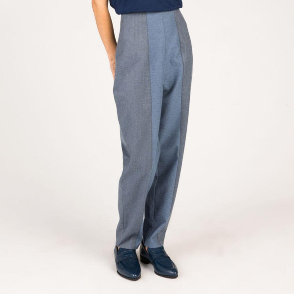 High-waisted blue and grey trousers with zipper on the side.