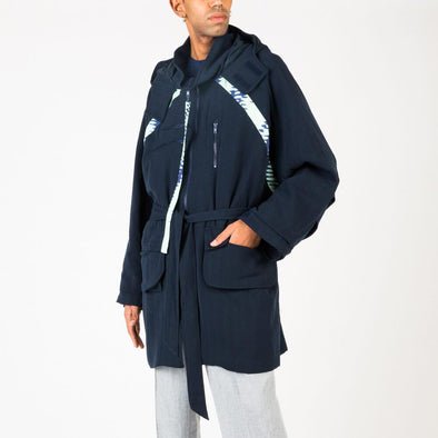 Navy blue coat with zipper and pocket details.