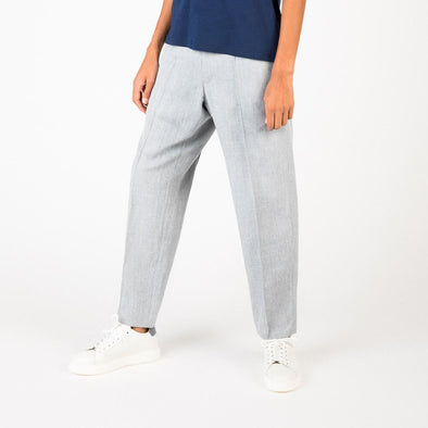 Elegant creased grey trousers.