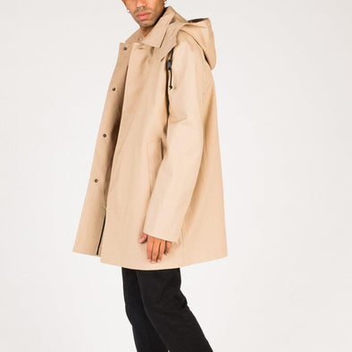 Beige timeless raincoat with piped front pockets and removable hood.