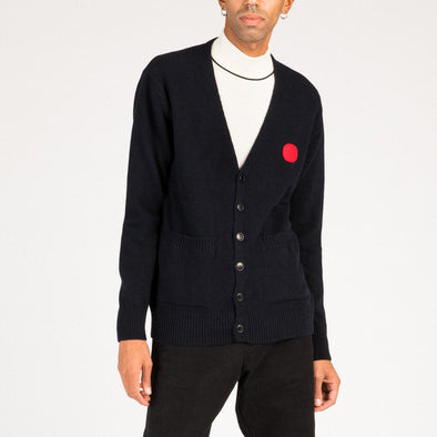 Black plain knit cardigan with red dot patch detail around the left side of the chest.