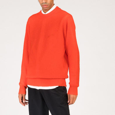 Regular fit coral wool jumper with dropped shoulder.