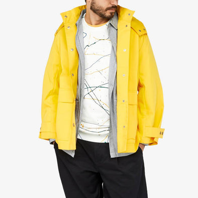 Regular fit parka with button fastening and oversize front pockets.