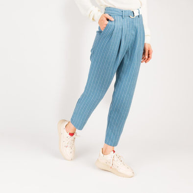 Blue and white striped peg leg trousers with contrasting o-ring belt.