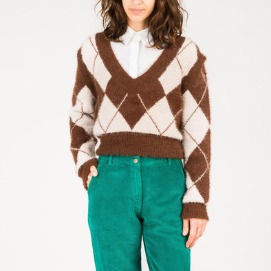 Fluffy-textured knit with detachable sleeves in brown and cream.