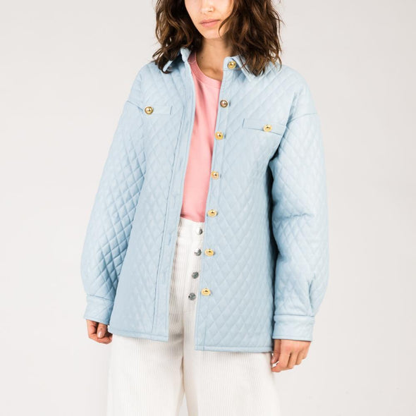 Light blue quilted jacket with vintage gold buttons.