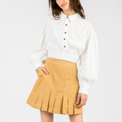 White relaxed fit cropped top with balloon sleeves.
