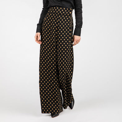 Black fluid trousers in a lightweight silky fabric.