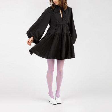 Relaxed fit babydoll dress with balloon sleeves.