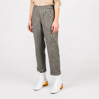Grey medium waist wool trousers with hidden side pockets.